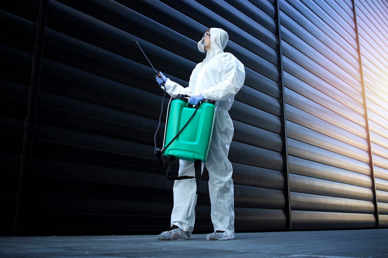 person-white-chemical-protection-suit-doing-disinfection-pest-control-spraying-poison-kill-insects-rodents